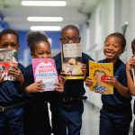 Wister Elementary students with books in hallway