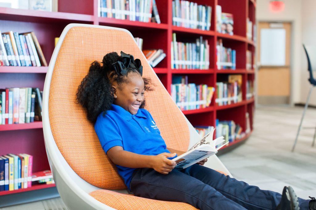 https://www.masterycharter.org/app/uploads/2017/09/Cramer-Hill.20172018library-smiles-girl-read-1024x681.jpg